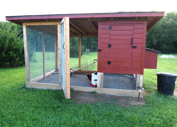 red chicken coop with run